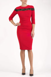 Model wearing the Diva Atlantis Pencil dress with three quarter length sleeves in true red and black front image