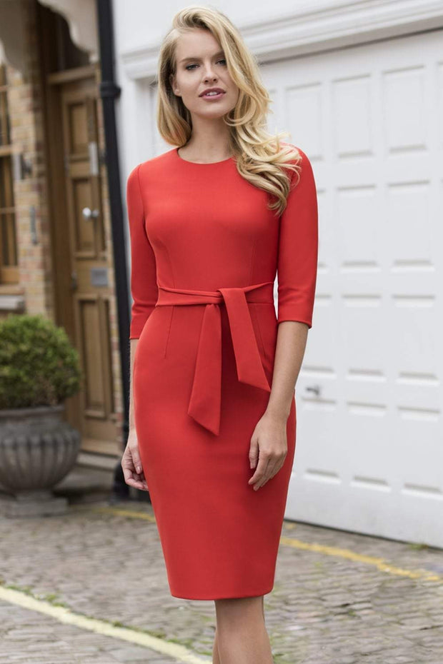 Model wearing the Diva Amatis Pencil dress with round neckline, inserted tie detailing at the front in burnt orange front image