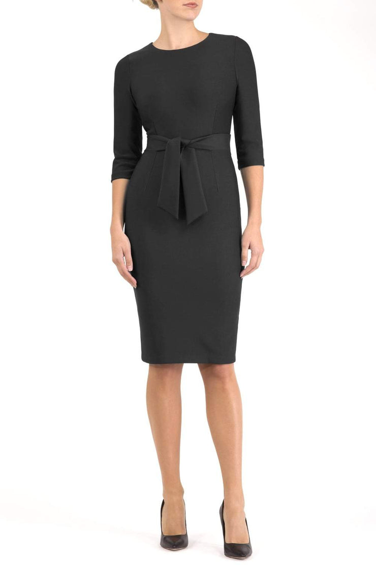 Model wearing the Diva Amatis Pencil dress with round neckline, inserted tie detailing at the front in black front image