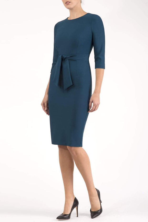 Model wearing the Diva Amatis Pencil dress with round neckline, inserted tie detailing at the front in glorious teal front image