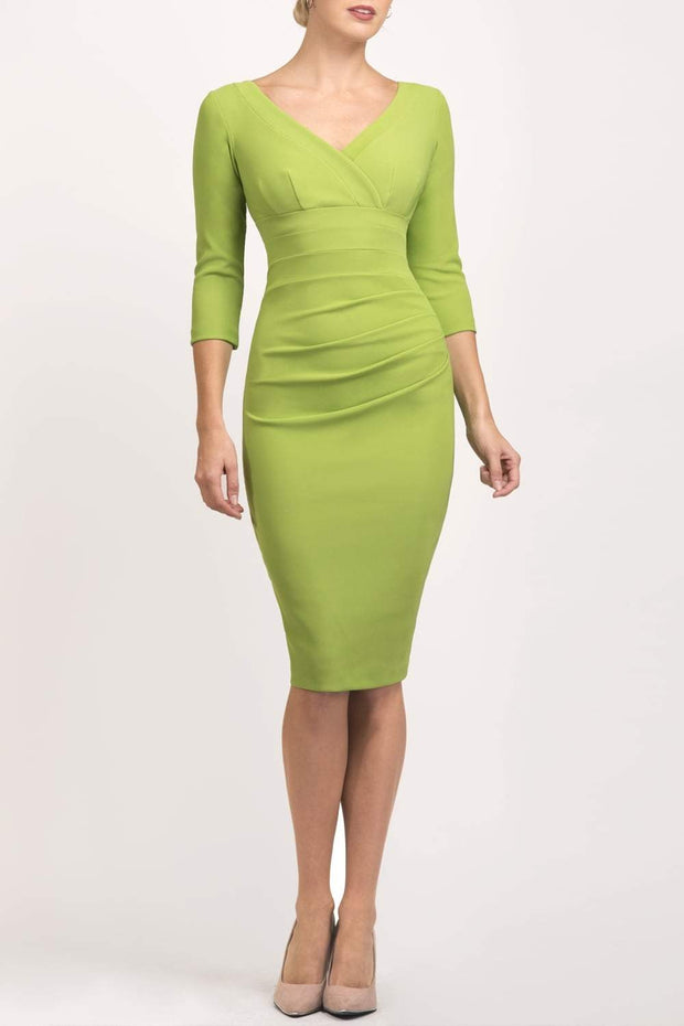 Model wearing the Diva Jemima dress in pencil dress design in jasmine green front image
