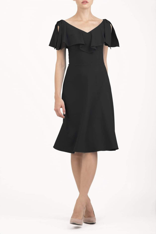 model wearing diva catwalk layla swing dress with bardot frill neckline in black front