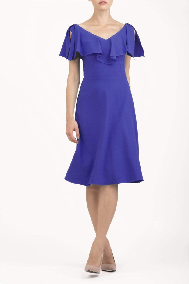 model wearing diva catwalk layla swing dress with bardot frill neckline in spectrum indigo front