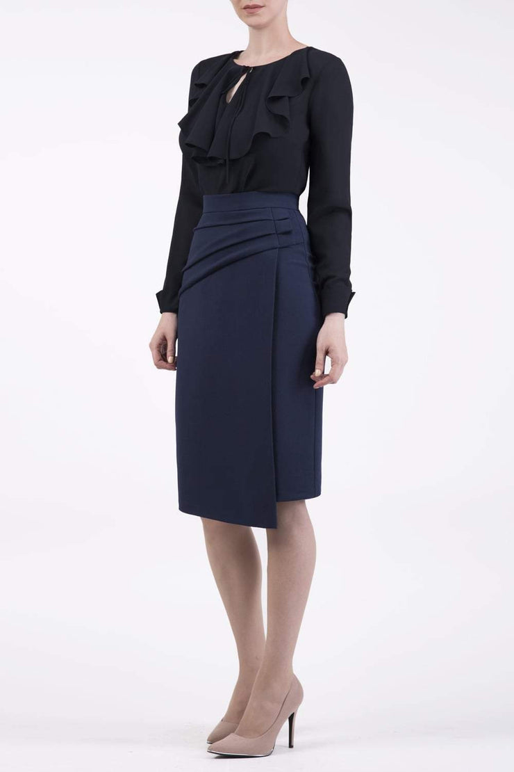 Model wearing the Diva Antibe Skirt knee length in navy front image