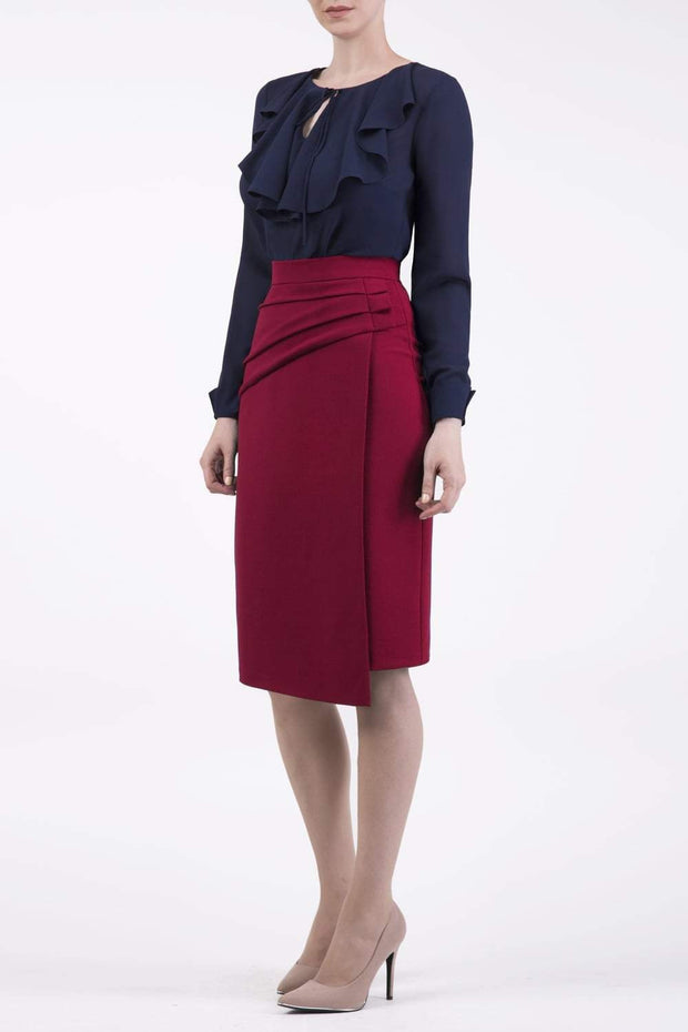model is wearing diva catwalk antibe pencil asymmetric skirt with pleating at the front in red front