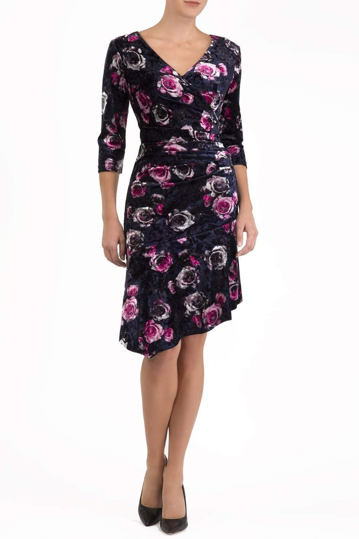 model wearing diva catwalk vella velvet printed asymmetric skirt dress with low v-neck and three quarter sleeves in navy and rose pink front