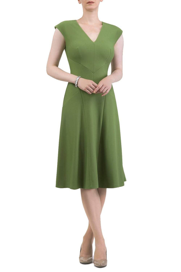model wearing diva catwalk rochelle swing skirt a line dress without sleeves with a low v neck in green front