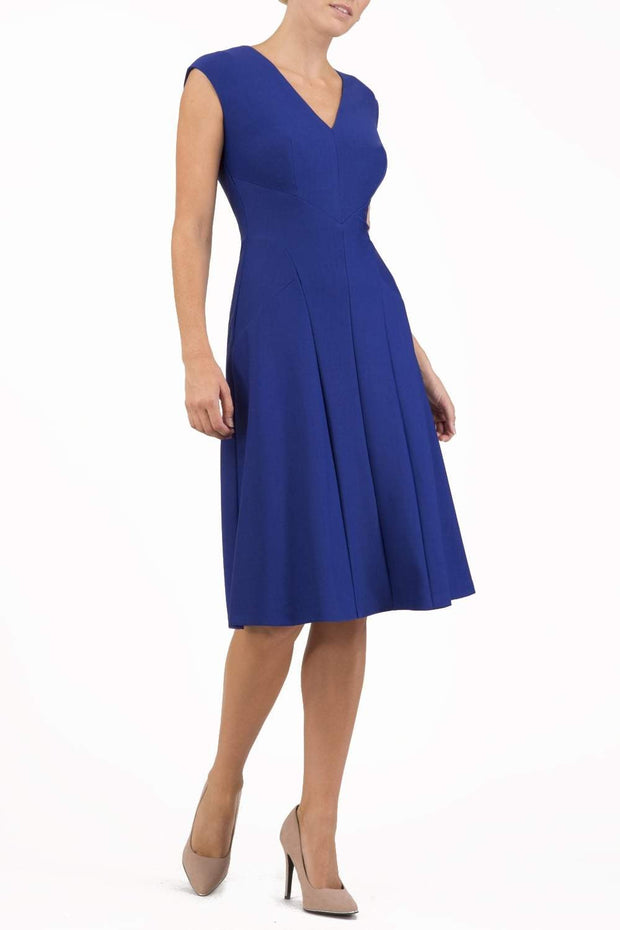 model wearing diva catwalk rochelle swing skirt a line dress without sleeves with a low v neck in cobalt front