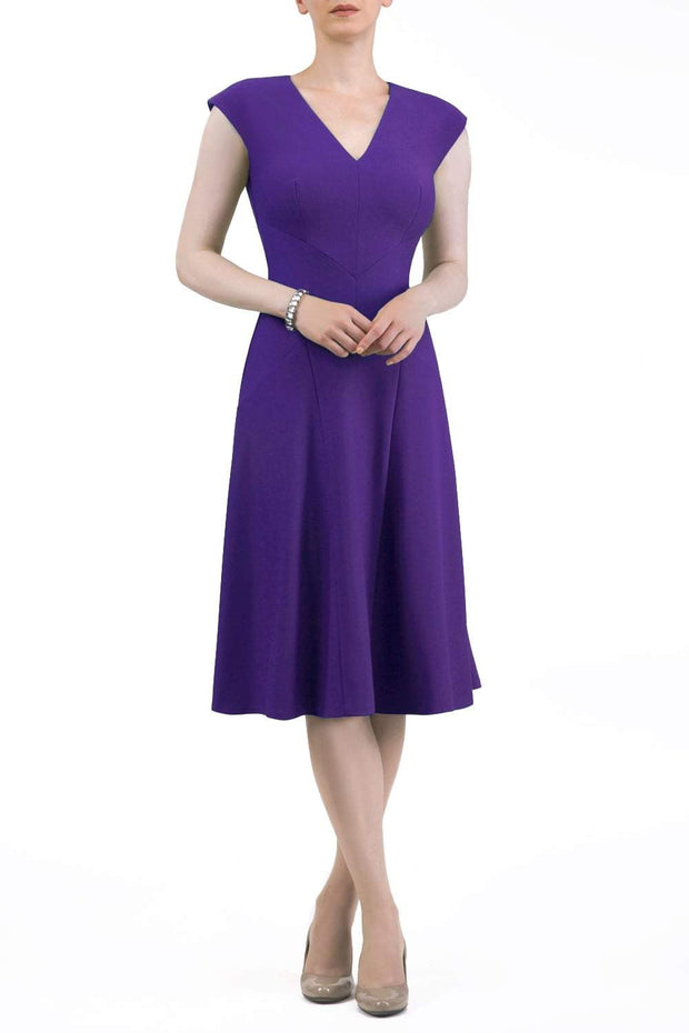model wearing diva catwalk rochelle swing skirt a line dress without sleeves with a low v neck in purple front