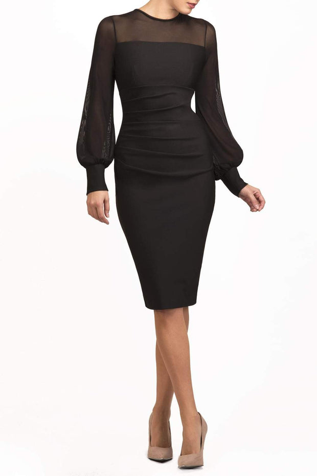 brunette model wearing diva catwalk black pencil dress with long sleeves knee length and mesh detail sleeves front