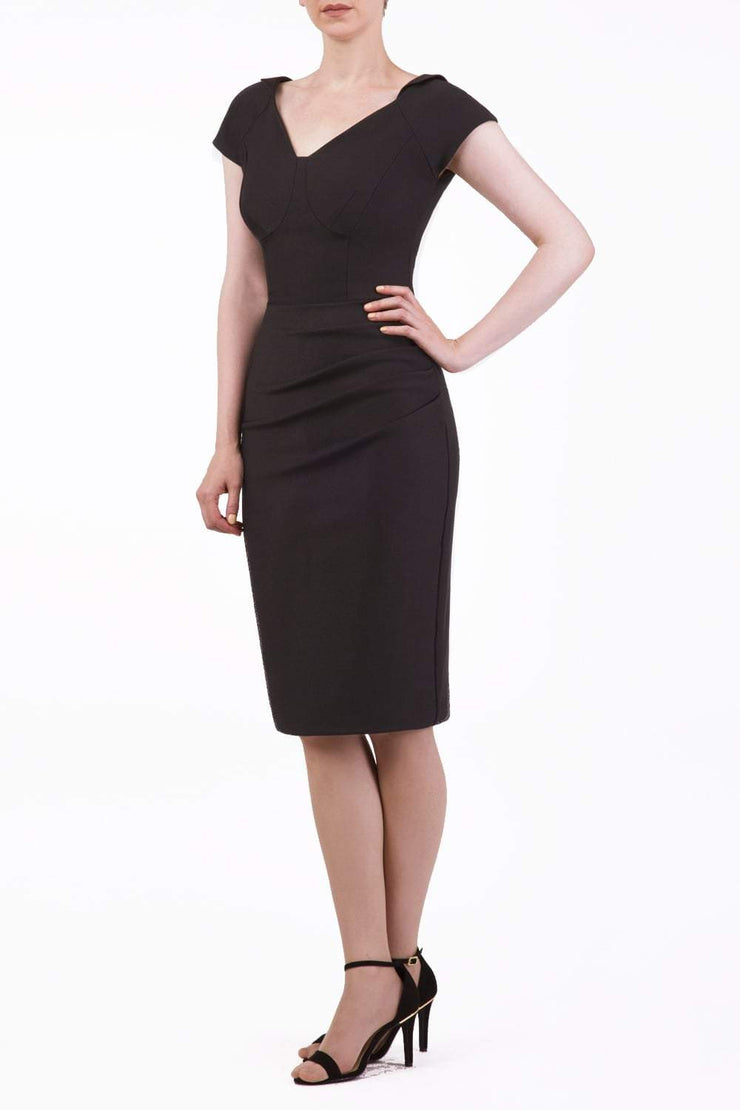 model wearing diva catwalk little black dresses with low v-nwcklinw and pencil skirt sleeveless style front