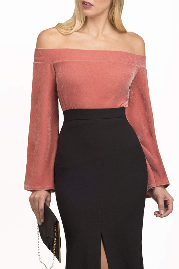 blonde model is wearing diva catwalk sistina velvet long glute sleeved top off shoulder bardot neckline in colour pink paired with black midaxi skirt front