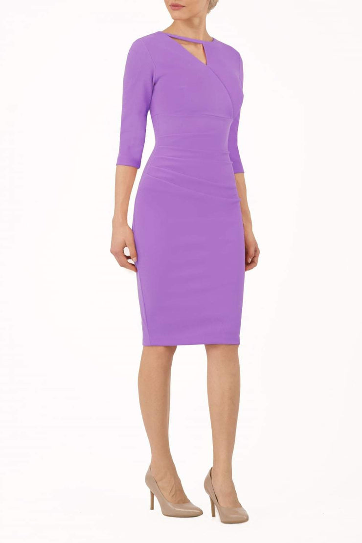 model wearing diva catwalk helston lilac pencil skirt  dress with sleeves and cut out detail on the neckline front