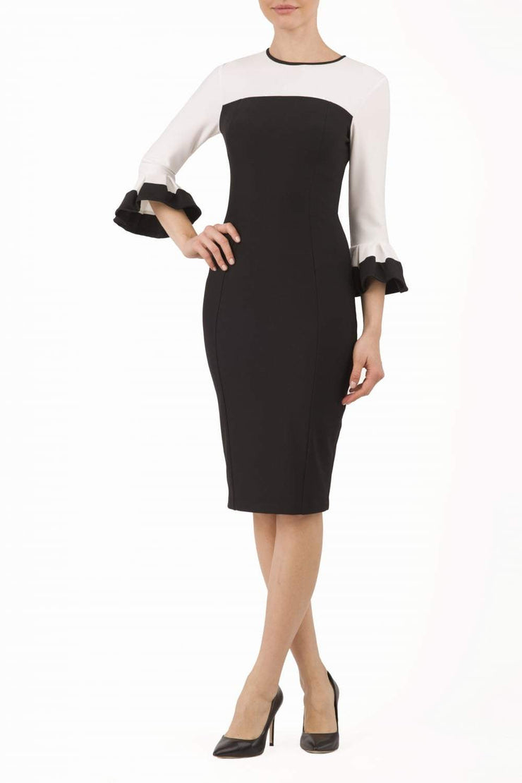 Model wearing the Diva Lyonia Pencil dress in pencil dress design in navy blue and ivory cream front image