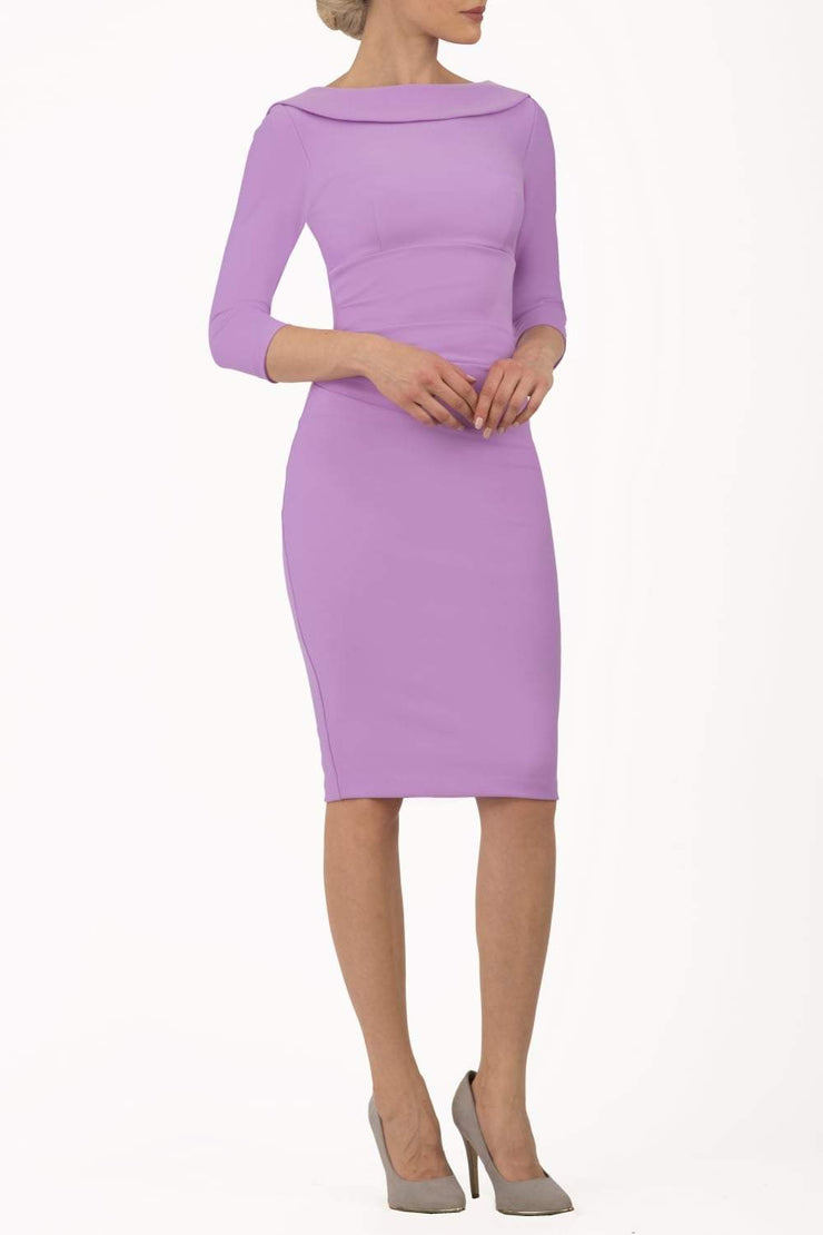 model wearing diva catwalk york pencil-skirt dress with sleeves and rounded folded collar and plearing across the tummy area in violet bloom colour front