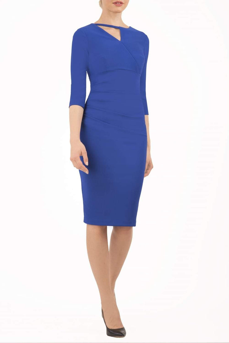 model wearing diva catwalk helston royal blue pencil dress with sleeves and cut out detail on the neckline front