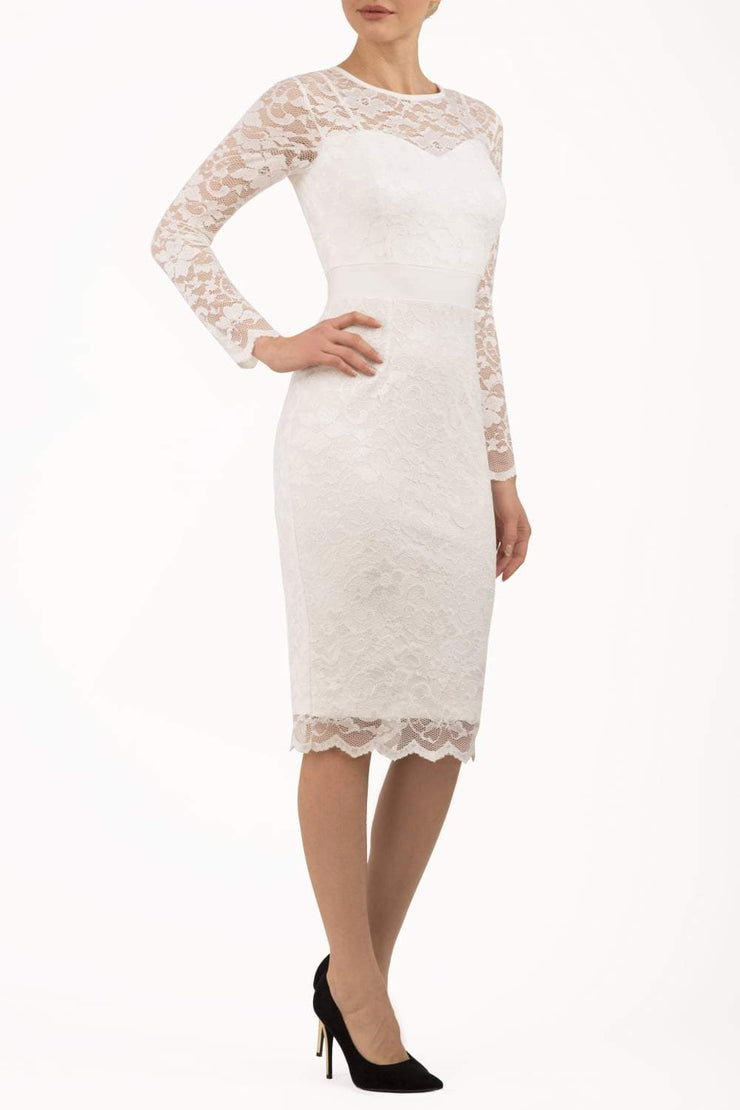 Model wearing the Diva Cherrie Lace Pencil dress with long sleeves and round neck in ivory cream front image