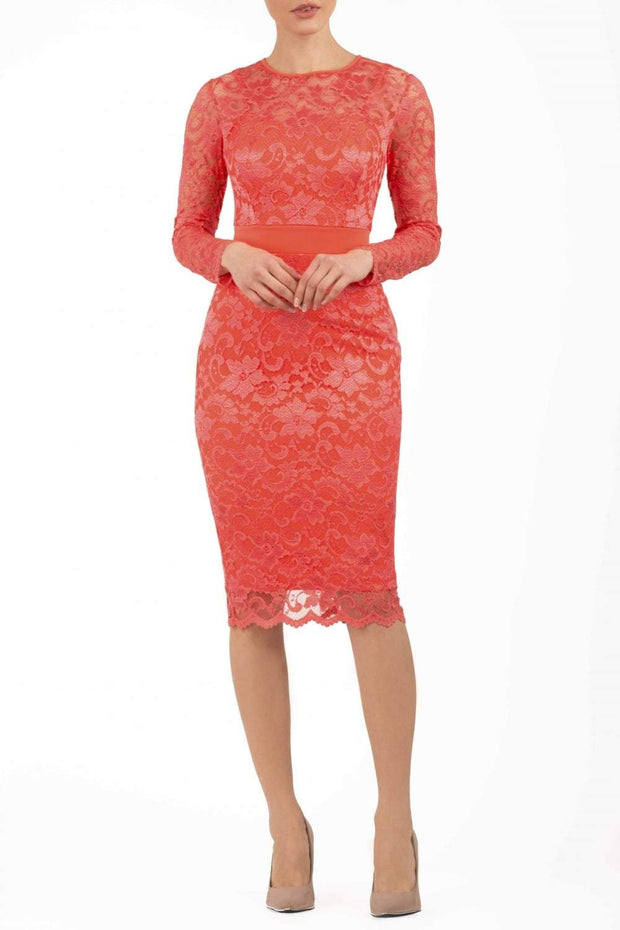Model wearing the Diva Cherrie Lace Pencil dress with long sleeves and round neck in hot coral front image