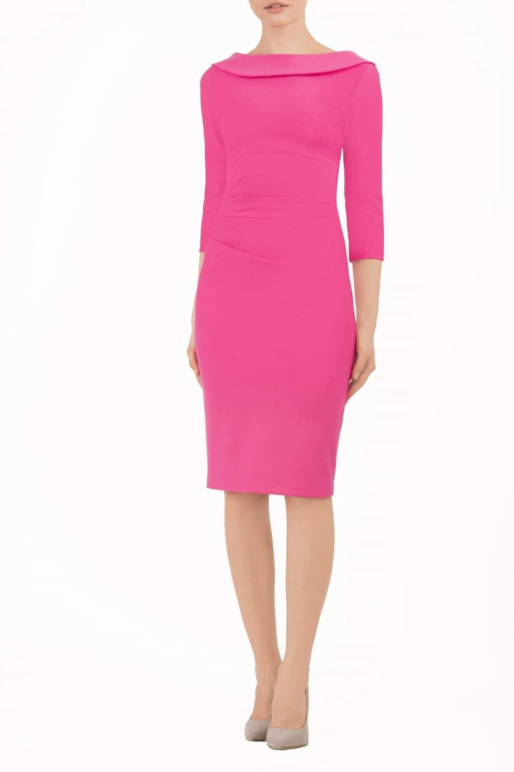 model wearing diva catwalk york pencil-skirt dress with sleeves and rounded folded collar and plearing across the tummy area in hibiscus pink colour front