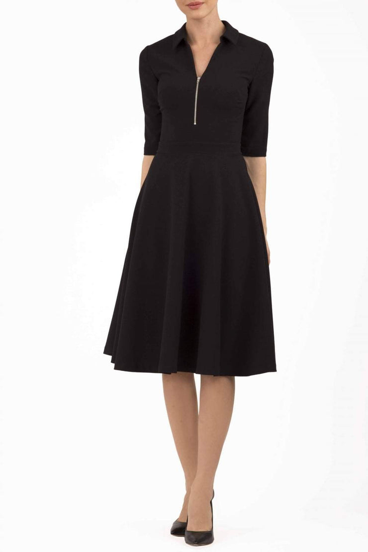 Model wearing the Diva Annette Swing Dress with V shaped neckline with zip detail in black front image