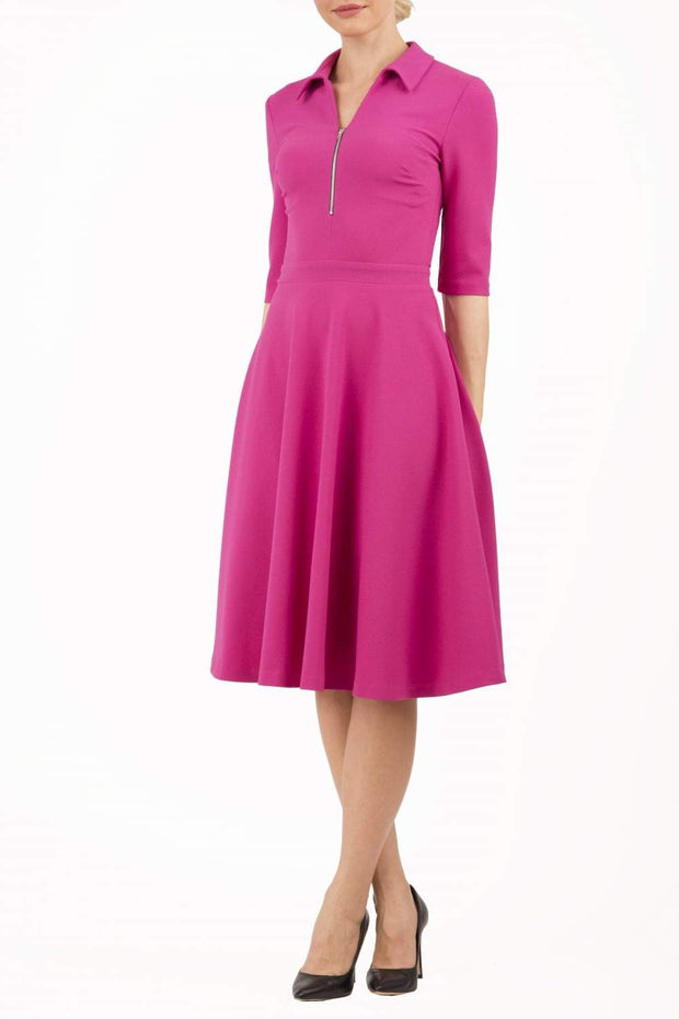 Model wearing the Diva Annette Swing Dress with V shaped neckline with zip detail in fuschia pink front image
