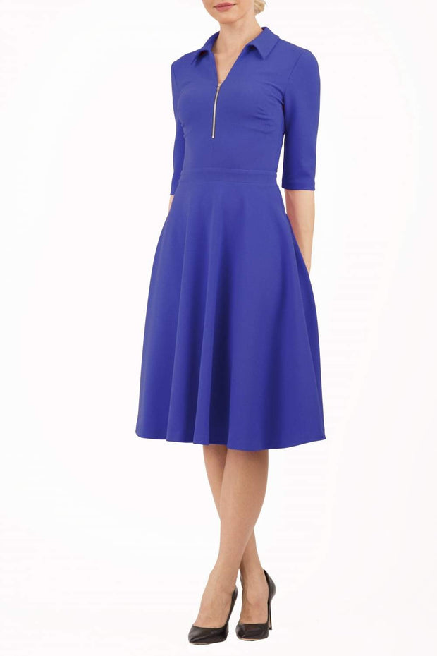Model wearing the Diva Annette Swing Dress with V shaped neckline with zip detail in riviera blue from image