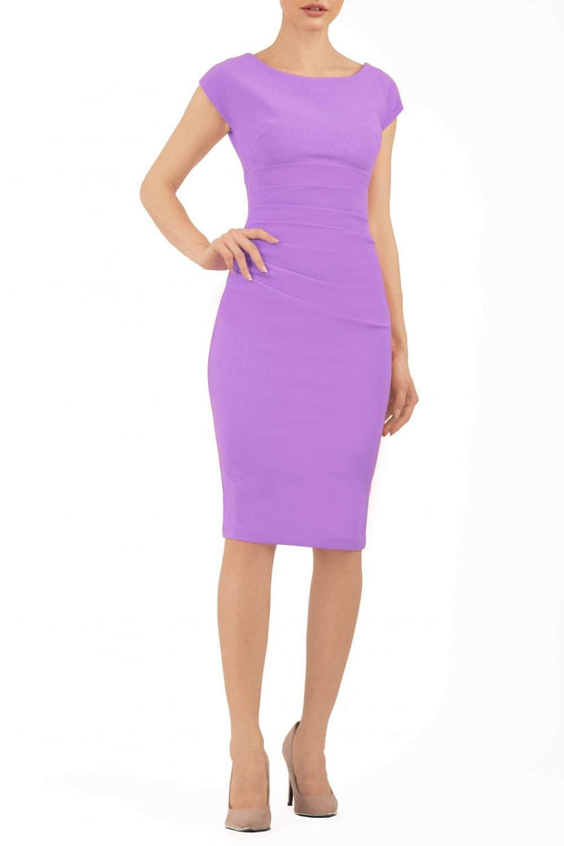 Model wearing Diva Catwalk Polly Rounded Neckline Pencil Cap Sleeve Dress with pleating across the tummy area in Violet Tulip front