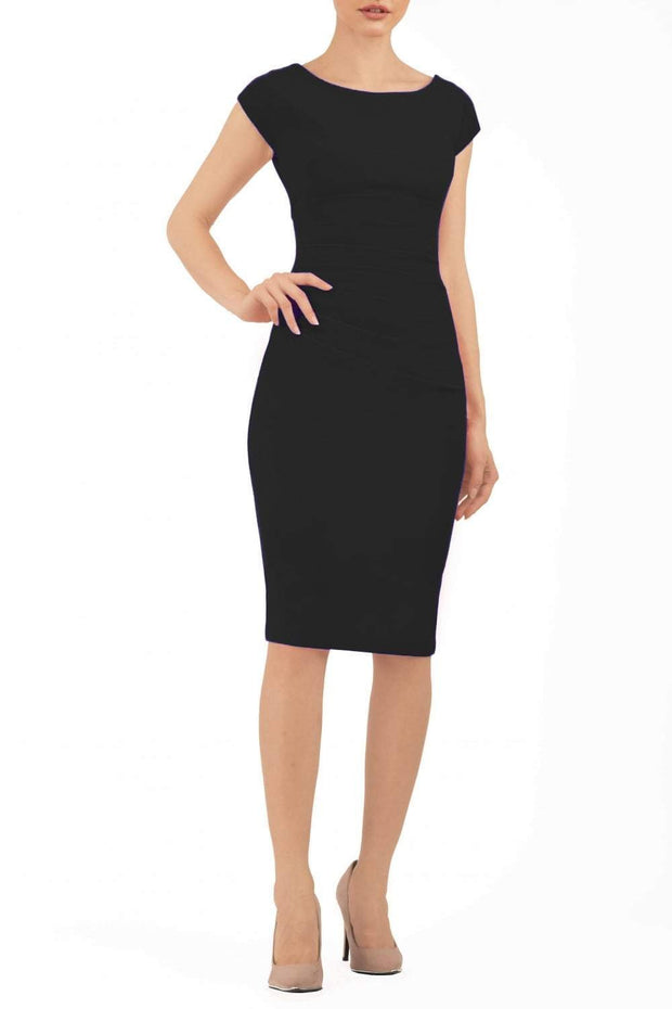 Model wearing Diva Catwalk Polly Rounded Neckline Pencil Cap Sleeve Dress with pleating across the tummy area in Black front