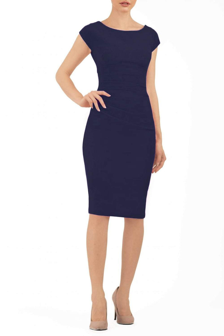Model wearing Diva Catwalk Polly Rounded Neckline Pencil Cap Sleeve Dress with pleating across the tummy area in Navy Blue front