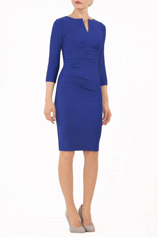 model wearing diva catwalk donna pencil dress in royal blue colour with wide band and sleeves and rounded neckline with low split in front