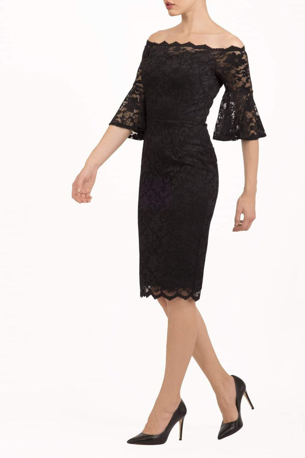 tall brunetter model wearing lace knee lenght pecill dress in black
