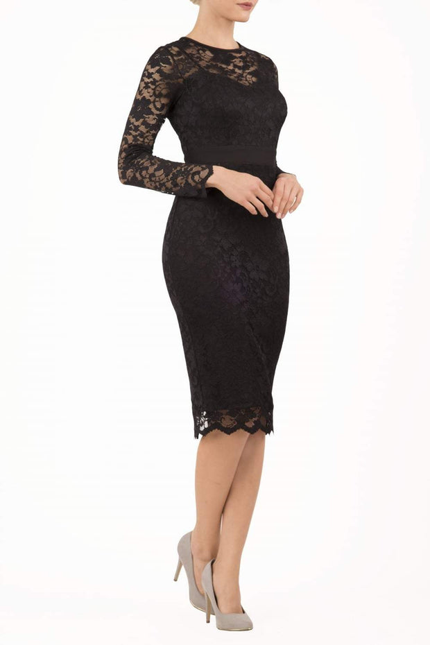 Model wearing the Diva Cherrie Lace Pencil dress with long sleeves and round neck in black front image