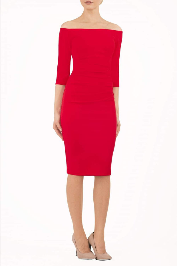 Model wearing the Diva Astra pencil dress with off shoulder design in true red front image