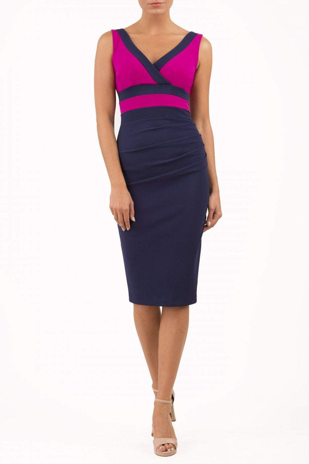 Model wearing the Diva Banbury Colour block dress with bust panels in contrast and pleating across the front in navy and magenta haze front image