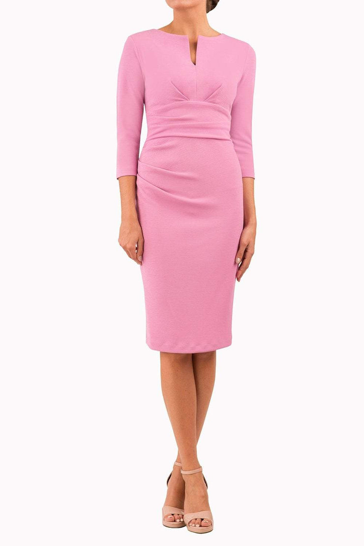 model wearing diva catwalk donna pencil dress in colour pink with wide band and sleeves and rounded neckline with low split in front