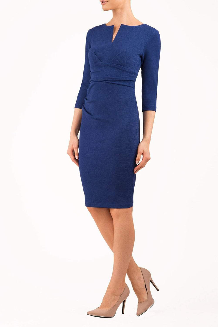 model wearing diva catwalk donna pencil dress in colour navy with wide band and sleeves and rounded neckline with low split in front
