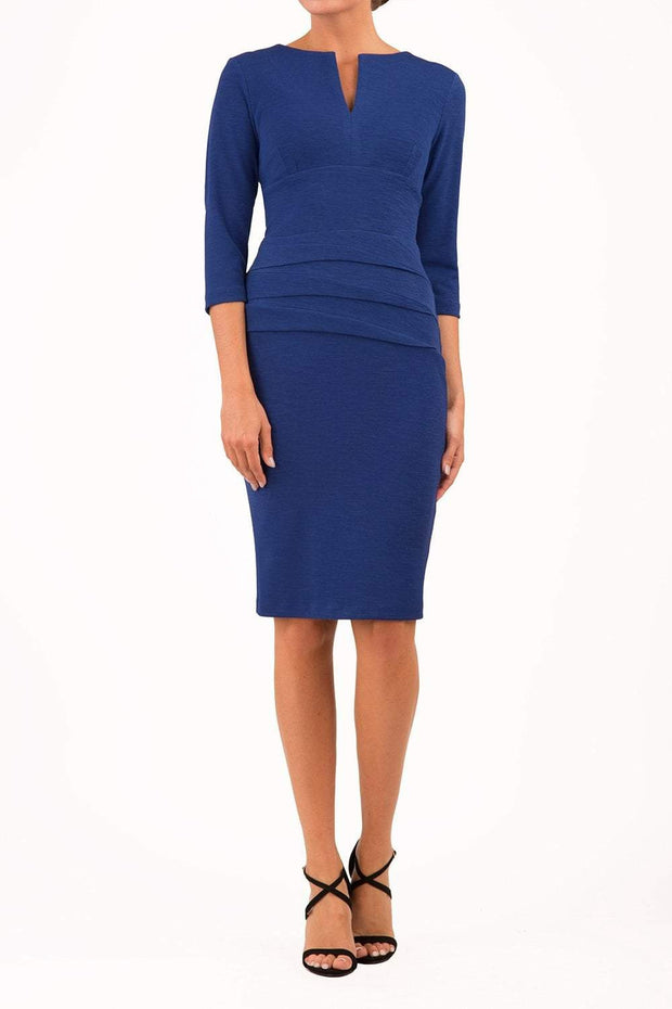 Model wearing the Diva Daphne Venice Stretch Pencil dress with pleat detail across the front in midnight blue front image