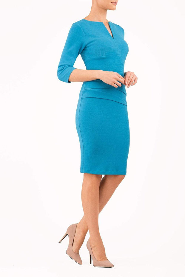 Model wearing the Diva Daphne Venice Stretch Pencil dress with pleat detail across the front in malibu blue front image