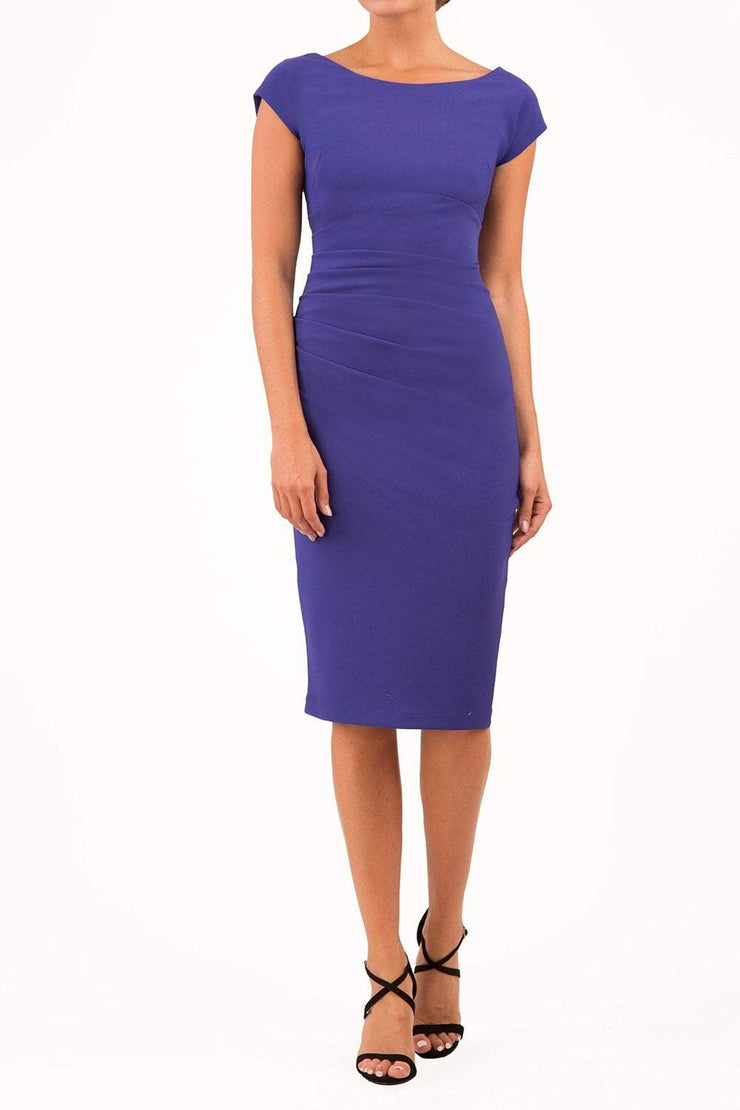 Model wearing Diva Catwalk Polly Rounded Neckline Pencil Cap Sleeve Dress with pleating across the tummy area in Deep Orient Blue front