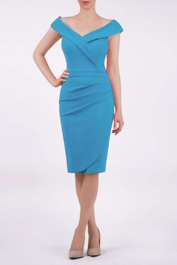 brunette model wearing diva catwalk evening pencil skirt dress sleeveless with lowered neckline and pleating on side in topaz teal colour front