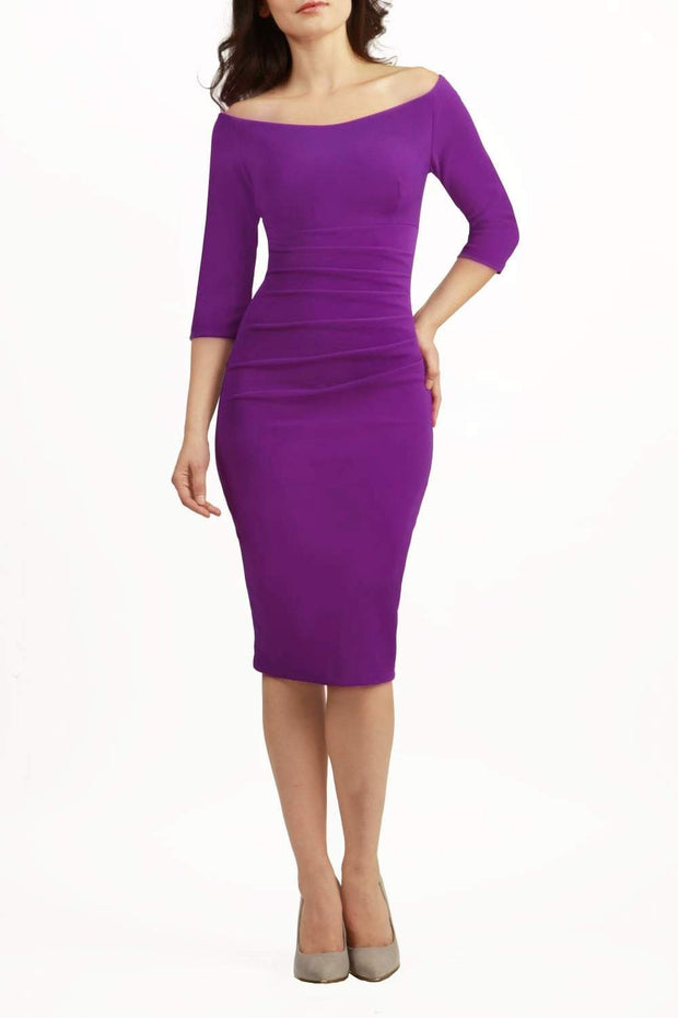 Model wearing the Diva Astra pencil dress with off shoulder design in violet purple front image