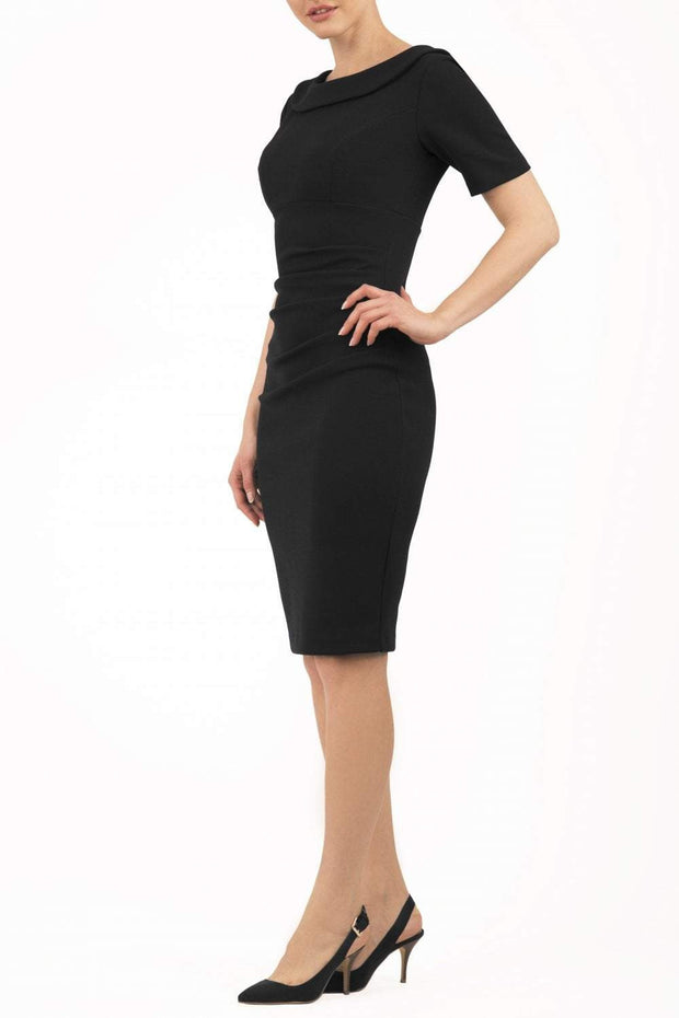 Model wearing the Diva Camille Marvel, pleat detail across front, fold at neckline in black front image