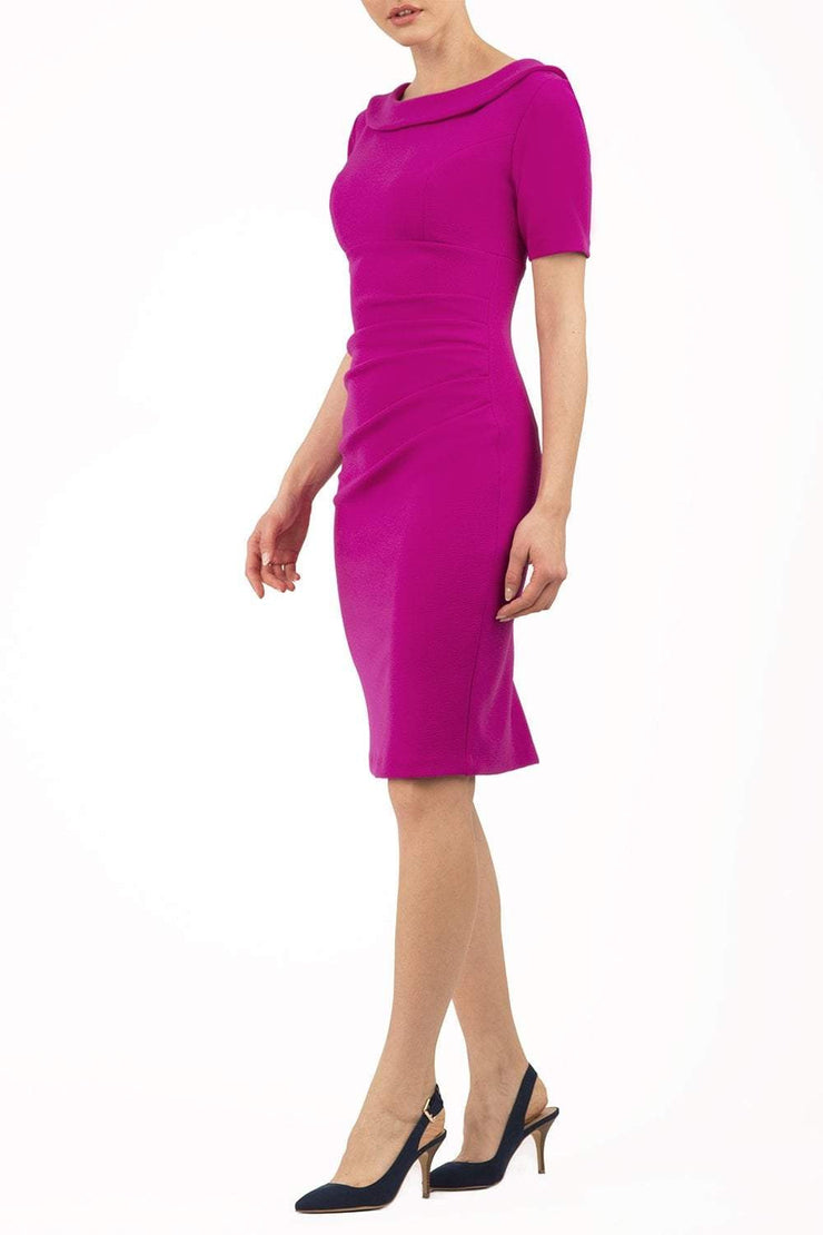 Model wearing the Diva Camille Marvel, pleat detail across front, fold at neckline in magenta front image