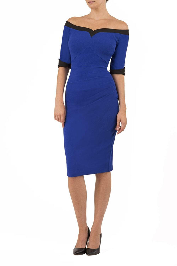 blonde model is wearing diva catwalk fellini sweetheart neckline fitted pencil dress with sleeves with cuff in colour royal blue with black contrasting detail front