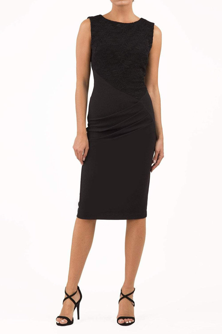 Model wearing the Diva Demelza Lace Pencil dress with lace stretch detailing and round neckline in black front image