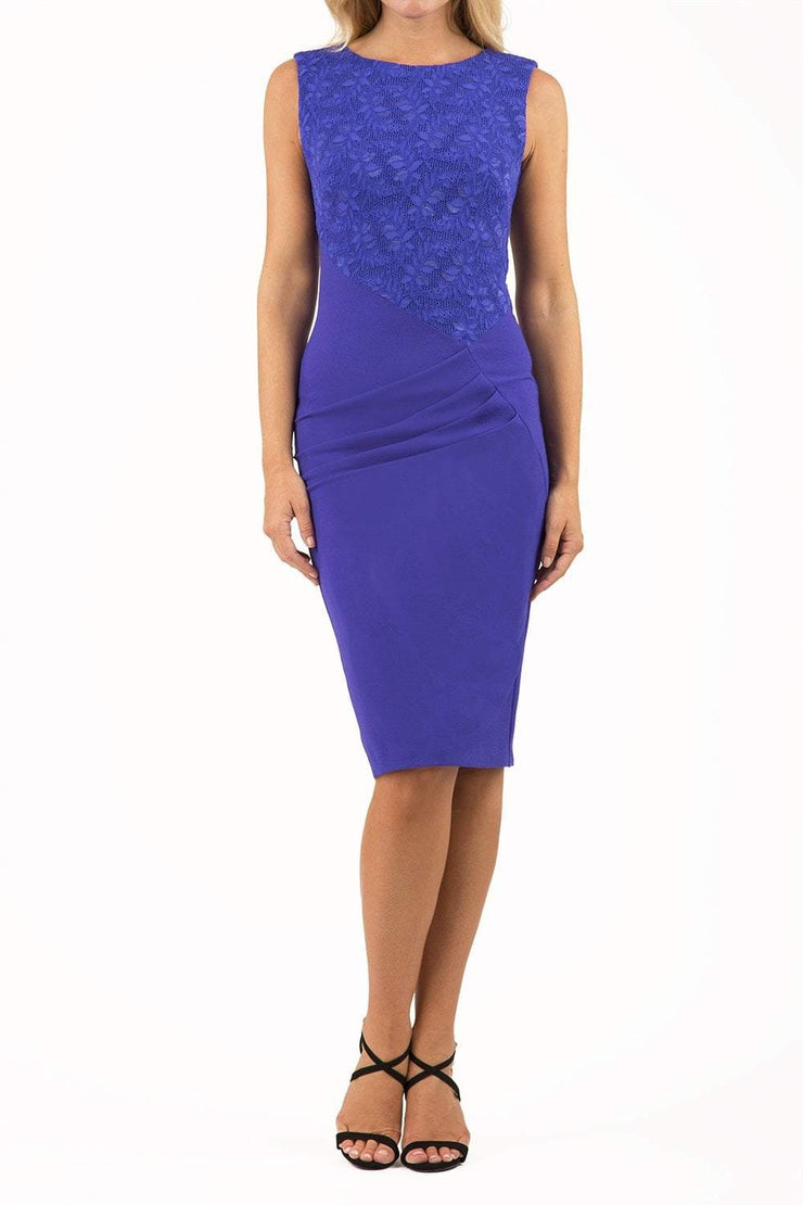 Model wearing the Diva Demelza Lace Pencil dress with lace stretch detailing and round neckline in spectrum indigo front image