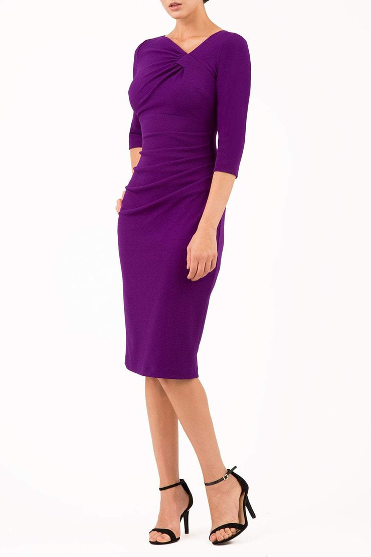 brinette model wearing diva catwalk kubrick pencil-skirt dress with sleeves and asymmetric neckline in deep purple front