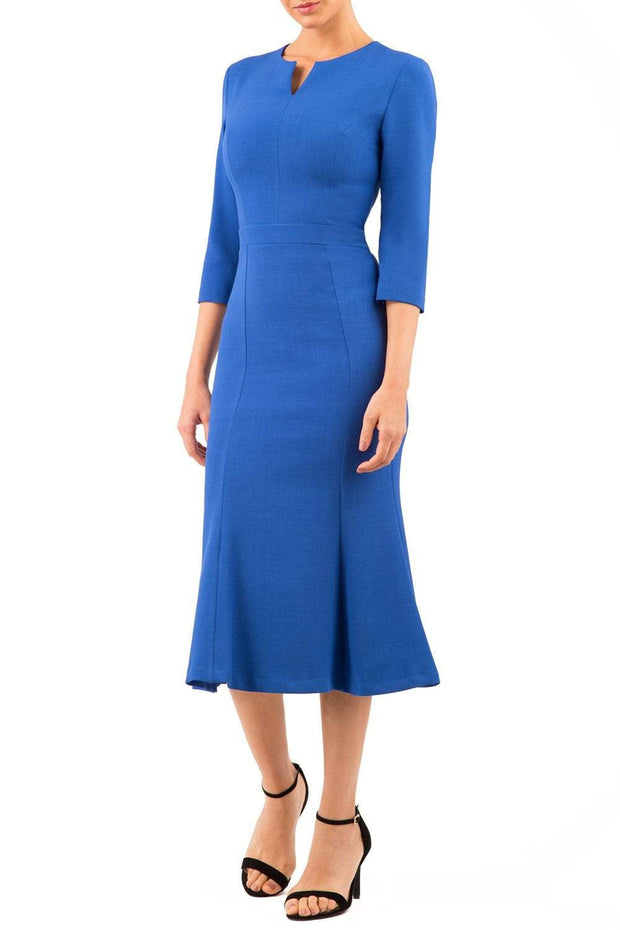 blonde model is wearing diva catwalk senne midaxi sleeved dress with fishtail and rounded neckline with a slit in the middle in royal blue front