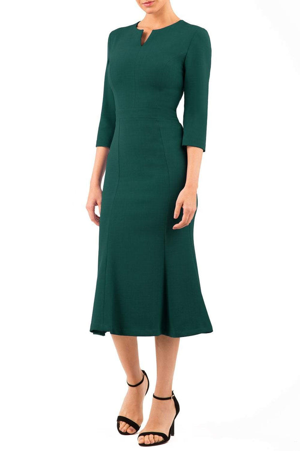 blonde model is wearing diva catwalk senne midaxi sleeved dress with fishtail and rounded neckline with a slit in the middle in forest green front