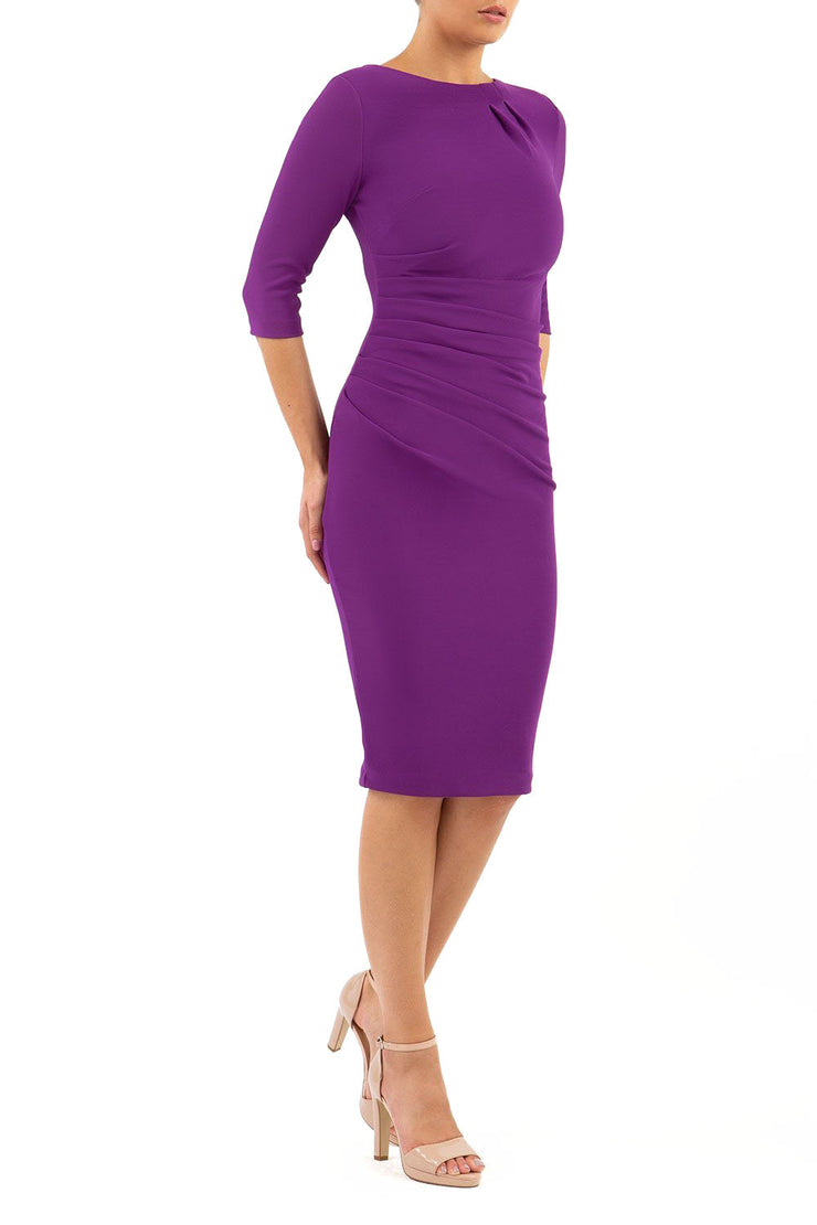 Model wearing the Diva Carlotta Pencil dress with pleat detail at the neckline and across the front in violet purple front image